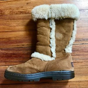 Tall fur-lined Ugg boots